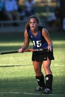 girl with stick, Field Hockey Player in Game