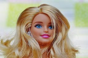 blue eyes and pink lips in a Barbie doll