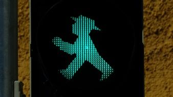 man at the traffic light as a light sign
