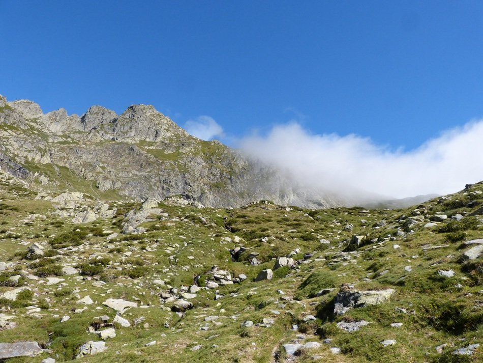 landscape of clouds over a mountain pass in the pyrenees