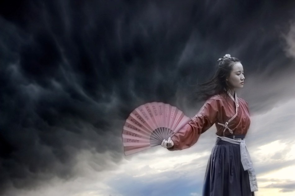 girl in a kimono with a fan in her hand