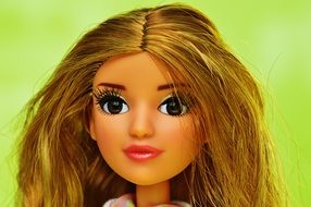 brown eyes and pink lips a doll with long hair