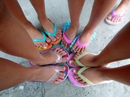 Feet of child girls in flip flop shoes