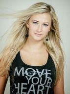 model blonde in a black tank with the inscription