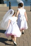 two flowergirls walking together