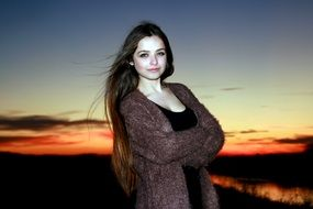 beautiful girl with long hair at sunset