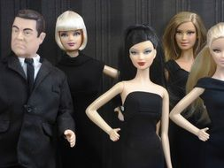 Barbie dolls in black dresses