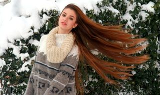 girl with long hair in winter garden