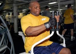man on a cardiovascular exercise machine