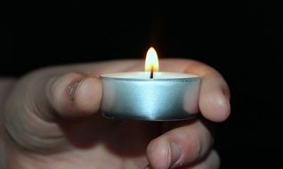 small candle in hand
