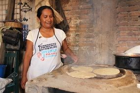 mexican woman cooking traditional food