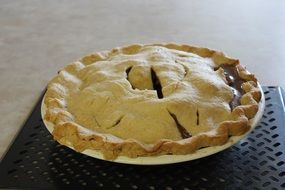 traditional apple pie on a plate