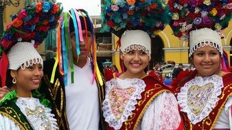 people in carnival costumes at a parade in Peru