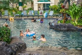 people in the pool at a hawaii resort
