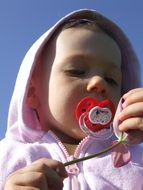cute girl with pacifier