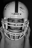 Boy in the Football Helmet