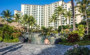 pool in front of a building in a hawaii resort