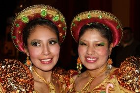 two women in colorful costumes at a festival in peru