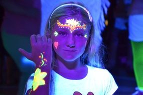 girl with luminescent face art