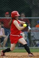 Swinging girl in red uniform, Softball
