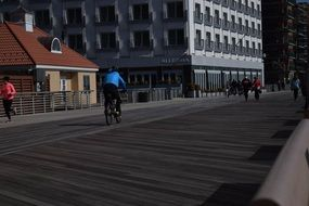 cyclist on a boardwalk in a long beach