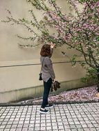 young girl at blooming tree