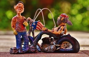 tattooist and biker as figures in the park