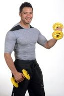 smiling muscular man with dumbbells