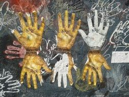 different hands on the Berlin Wall