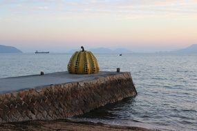 pumpkin sculpture on pier in japan