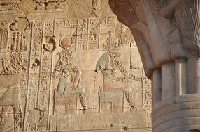 hieroglyphs and pharaohs on the walls of the Egyptian temple
