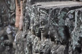 persons in the temple complex in cambodia