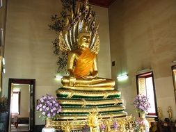 golden Buddha statue in Thai temple