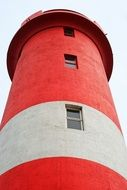 red and white lighthouse close up