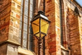 street lamp on a brick wall of a building