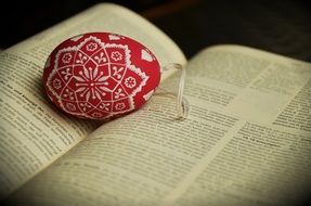 red easter egg on bible