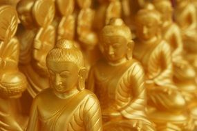 gold figures of Buddha