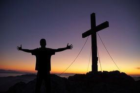 cross and man with open arms