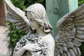 white stone angel statue with wings in the park