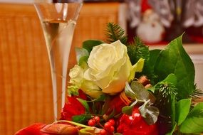 glass of champagne and flower bouquet