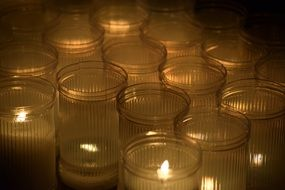 burning candles in jars