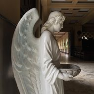 white Angel with bowl, Sculpture in Church