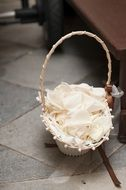wicker basket with white flowers