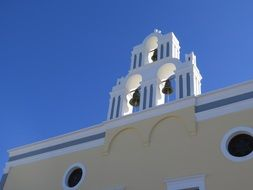 white church with bell tower on Santorini island