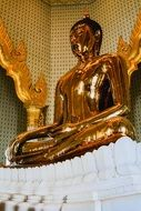 statue of golden buddha in thailand temple