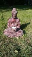 figure of mediating buddha in the garden