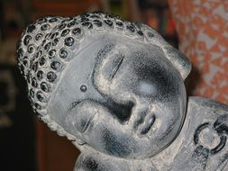 stone figure of meditating buddha