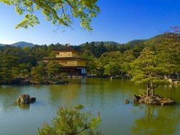 distant view of the temple of the golden pavilion in japan