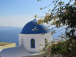 blue dome of a church in Santorini