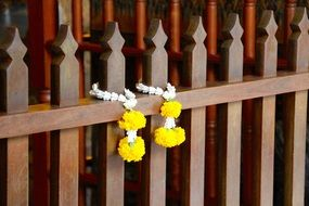 decorations with yellow flowers on a wooden fence